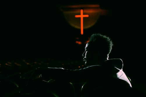 Man and Cross by Gift Habeshaw-449311-unsplash